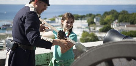 Soldier and Young Girl Loading Cannon Fort Mackinac