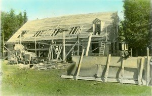 The barracks under construction and nearing completion with members of the CCC crew, 1934.