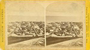 Stereoview, ca. 1870. The original Mackinac Hotel is the fifth building from the corner on the land side of Main Street.