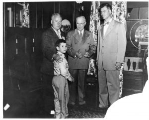 Brian and James Dunnigan with President Truman and Michigan Governor G. Mennen Williams. 1955