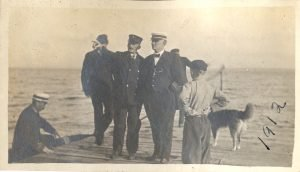 Some visitors, like this Lighthouse Service inspector being greeted by Keeper George Marshall, came on official business.