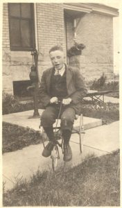 Chester Marshall, nephew of keeper George Marshall, plays near the water pump behind the keepers' quarters.