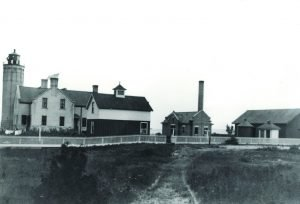 The station grounds as they appeared around 1918. The privy and oil house are located at right. Courtesy State Archives of Michigan