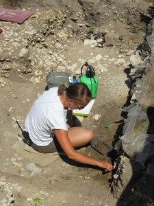 MSHP staff member Alex excavating in the root cellar.