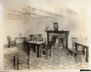 The interior of the east dining room, ca 1925 showing the recently installed ceramic tile floor and chandelier.