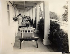The lower level of the Fort Mackinac Tea Room under the porch of the Officer's Stone Quarters, ca. 1925. Several examples of the unique benches and tables are today preserved in the park's collection.
