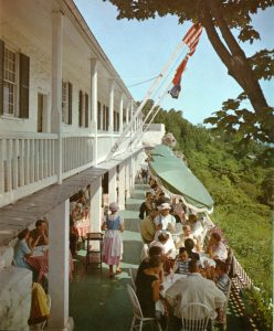 Patrons enjoying lunch with a view, ca. 1965. Note the colonial-style uniforms worn by the waitresses.