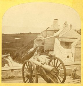 Howitzers, such as the one seen in this mid-1870s photo, had shorter barrels and could fire in a higher arc than a cannon.