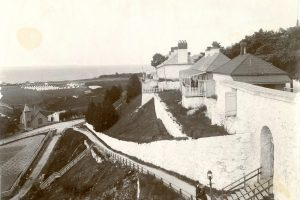 Fort Mackinac during a summer encampment- note the tents in the distance, pitched on the government pasture.