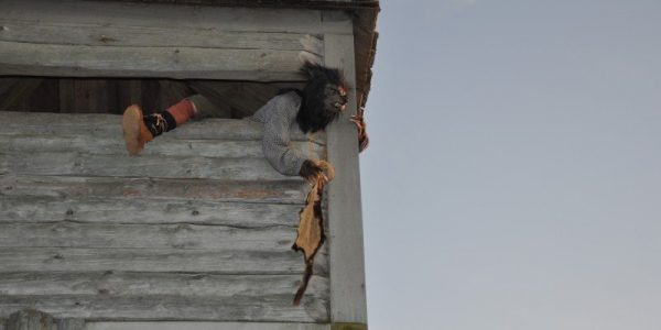 A Werewolf watches as unsuspecting visitors enter Fort Fright.